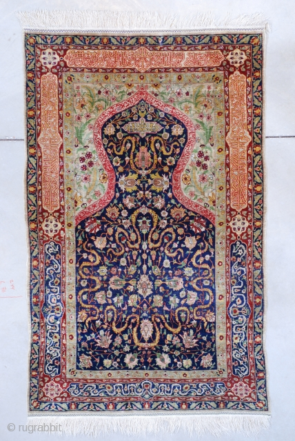 """#7597 Hereke This silk and metal Hereke measures 3'3"""" X 5'2"""" (100 x 158 cm). It has a blue field with a cloudband motif and flowers. The spandrels are a pale shade of  ..."""