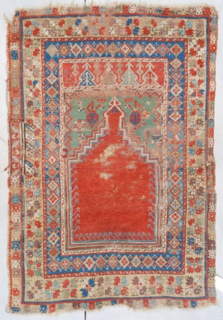 "This old Mudjur (Mucur) measures 3'9"" X 5'3"" (118 x 161 cm). This little prayer rug displays beautiful colors. The tomato red step prayer field outlined in green, ivory and aubergine rises  ..."