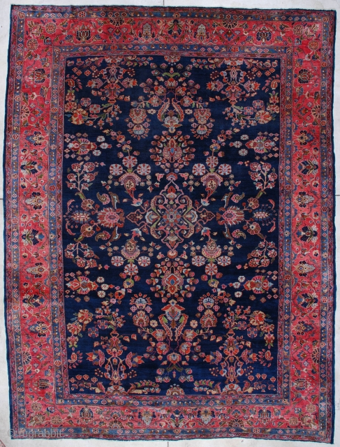 """#7050 Mahajaran Sarouk  This circa 1920s Mahajaran Sarouk measures 9'1"""" X 11'10"""". It has the so-called empty design motif with a floral medallion.  It has over all bunches of flowers in pale  ..."""