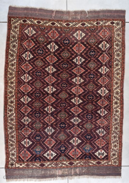 "This circa 1860 Turkoman Chodor Oriental Rug measures 6'8"" X 9'3"" (203 x 282 cm). It has a medium to dark chocolate brown field with a diamond shaped motif in pale red,  ..."