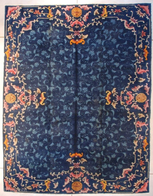 """This circa 1930 Art Deco Chinese Rug #7665 measures 8'11"""" X 11'8""""(273 x 359 cm). It is a dark blue Chinese rug with an overall field design of leaves and flowers in  ..."""