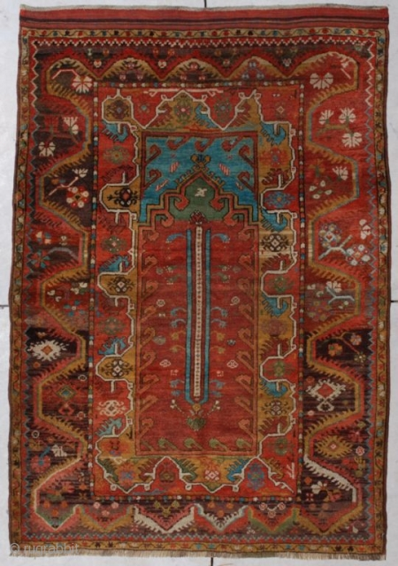 "http://www.antiqueorientalrugs.com/CLOSEUP%20PAGES/6787%20Turkish%20Melez.htm This circa 1875 Melez measures 3 '11"" x 5' 7"". The prayer design arches are in medium green.  The spandrels are in Mediterranean blue.  It has a  ..."