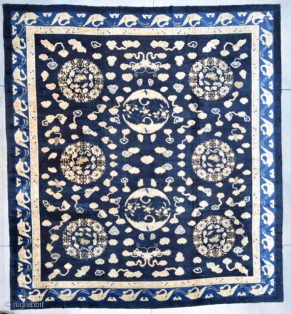 """#7080 Peking Chinese  This antique Peking Chinese rug measures 14'0"""" X 15'5"""" (425 x 471 cm). It has a navy blue ground with six flower wreaths containing an antlered dear.  There are  ..."""