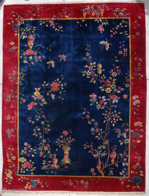 """#7133 Art Deco Chinese Rug  This circa 1920 Art Deco Chinese Oriental carpet measures 8'9"""" X 11'8"""". It has a uni-directional floral design with a very interesting twist…some of the main branches end  ..."""