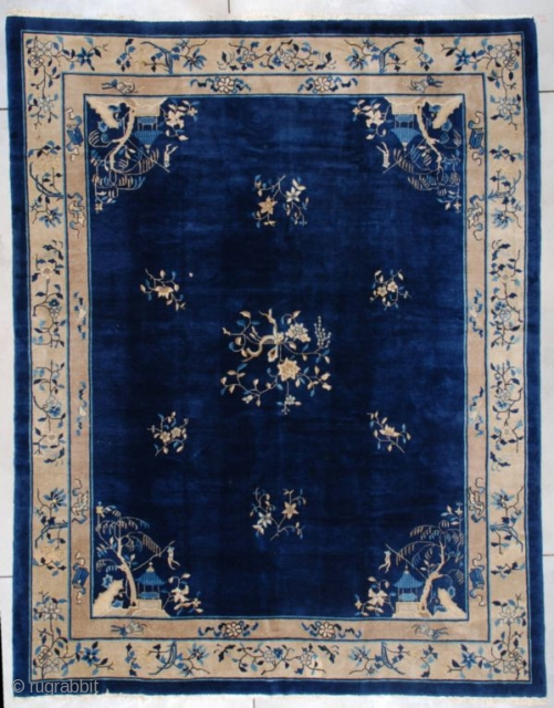 "This circa 1900 Peking Chinese Oriental rug measures 9'2"" X 11'8"". It has a very dark blue field with corners worked in idyll water scenes of a rockery with a willow tree  ..."