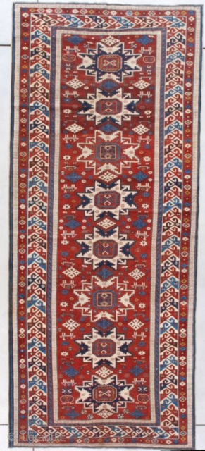 """#7624 Lesghi Shirvan Long Rug  This late 19th century Lesghi Shirvan Long Rug measures 4'1"""" X 9'5"""" (125 x 289 cm). It has the rare and very heavenly red ground with eight  ..."""