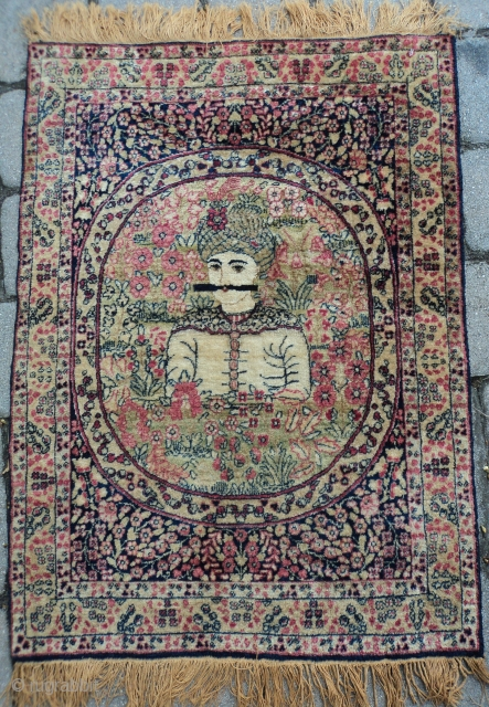 """#7557 Laver Kerman This circa 1890 Laver Kerman Picture rug measures 2'0"""" X 2'9"""" (61 x 88 cm). I believe this is a depiction of Nadar Shah with that big black luscious mustache.  ..."""