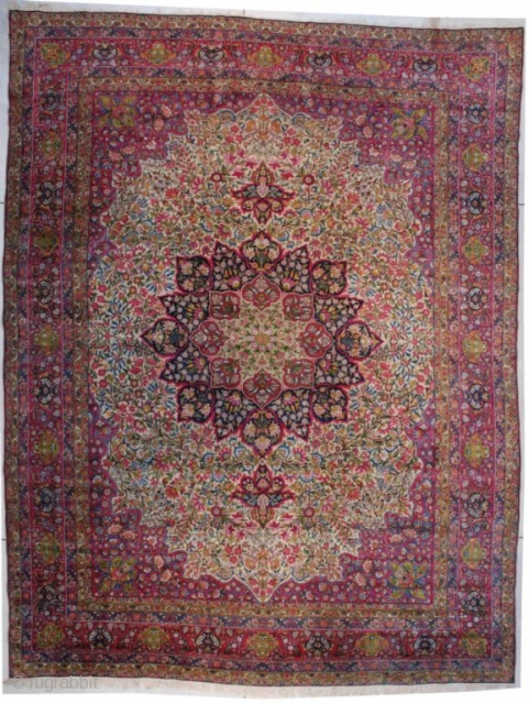 """7385 Laver Kerman  This circa 1890 Laver Kerman measures 12'3"""" X 16'0"""" (374 x 486 cm). It has an ivory field completely covered in green foliage with touches of red and magenta. There  ..."""
