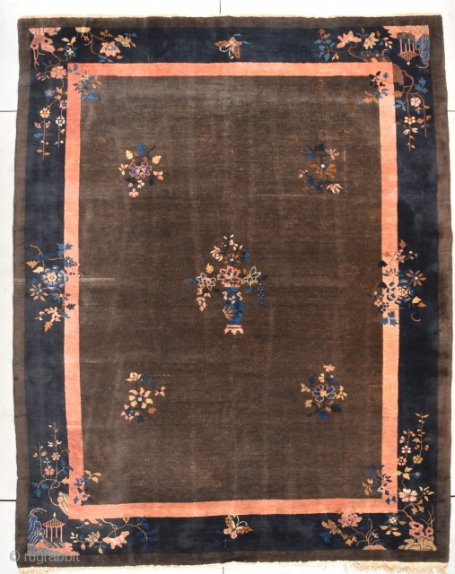 """This circa 1930 Peking Chinese rug #7850 measures 9'0"""" X 11'5"""". It has a deep chocolate brown field with five multi-colored flower sprays in the field, one of which is a beautiful  ..."""