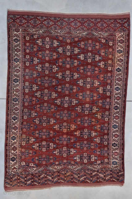 """Antique Yomud Oriental Rug  #7844 This late third quarter 19th century Yomud measures 6'6"""" X 9'6"""". It has a deep red field covered in Kepse guls in ivory, blue, apricot and lots  ..."""