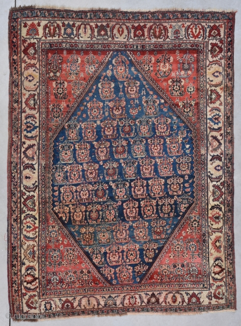 """This fourth quarter 19th century Quashki measures 3'11"""" X 5'5"""". It is beautifully drawn with a very nice abrash. The center medallion is a diamond shape on a blue ground with four  ..."""