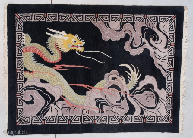 """#7519 Art Deco Chinese Rug  This circa 1920 Chinese Oriental rug measures 3'8"""" X 5'1"""" (115 x 155 cm). It has a multicolored dragon in green, gold, ivory, red and teal winding through  ..."""