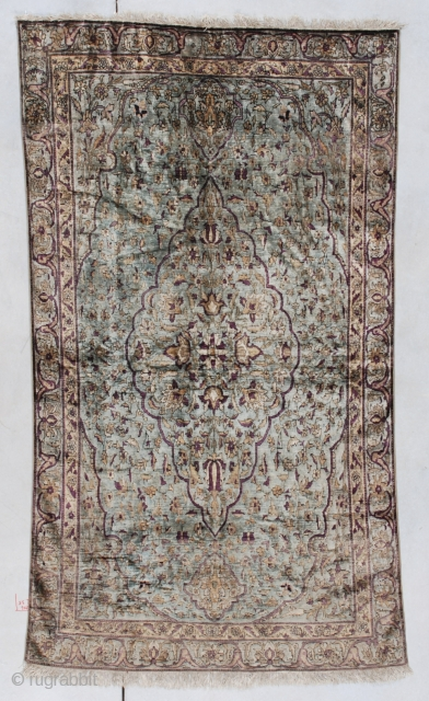 """#7536 Antique Silk Fereghan  This Silk Fereghan measures 3'6"""" X 6'6"""" (109 x 201 cm). It has a medium pale blue background with an overall floral design and a center medallion. The highlights  ..."""