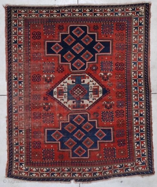 "http://www.antiqueorientalrugs.com/CLOSEUP%20PAGES/7173%20Kazak.htm This late 19th century Lori Pambeck Kazak measures 6'4"" x 7'9"". It has three medallions in medium blue, dark blue and ivory with a very typical Lori Pambeck motif. It has  ..."