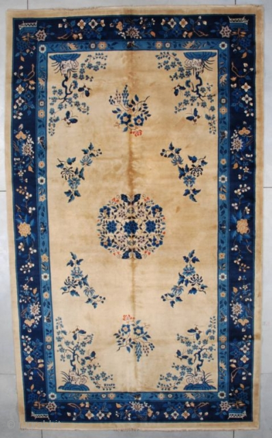 """#7514 Peking Chinese Rug  This very lovely, circa 1930 oversized Peking Chinese Oriental rug measures 10'0"""" X 16'9"""" (304 x 515 cm). It has an old ivory colored field with a center medallion  ..."""