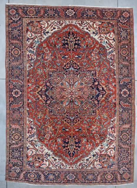 """#7695 Heriz Oriental Rug  This circa 1930 Heriz handmade Oriental Rug measures 9'6"""" X 13'3"""" (292 x 401 cm). It has a tomato red field with an overall combination geometric and floral motif  ..."""