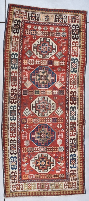 """Antique Akstava Caucasian Rug Runner #7955 This circa 1890 Akstava measures 3'6"""" x 8'4"""" (109 x 256 cm). It has five Memling guls in ivory and blue on a red ground. The  ..."""