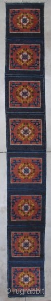 "http://www.antiqueorientalrugs.com/CLOSEUP%20PAGES/7197%20ningxia%20runner.htm This late 19th century Ningxia runner measures 2'1' X 17'8"". It is comprised of nine meditation squares in burnt sienna with Chinese fretwork in the corners and a wreath of yellow  ..."