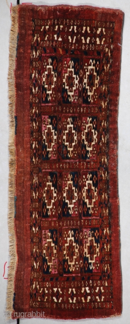 """#7356 Yomud Torba  This third quarter 19th century Yomud Torba measures 2'6"""" X 11"""" (79 X 33cm). It is a very nicely drawn 12 panel Torba. The guls are outlined in white wool.  ..."""