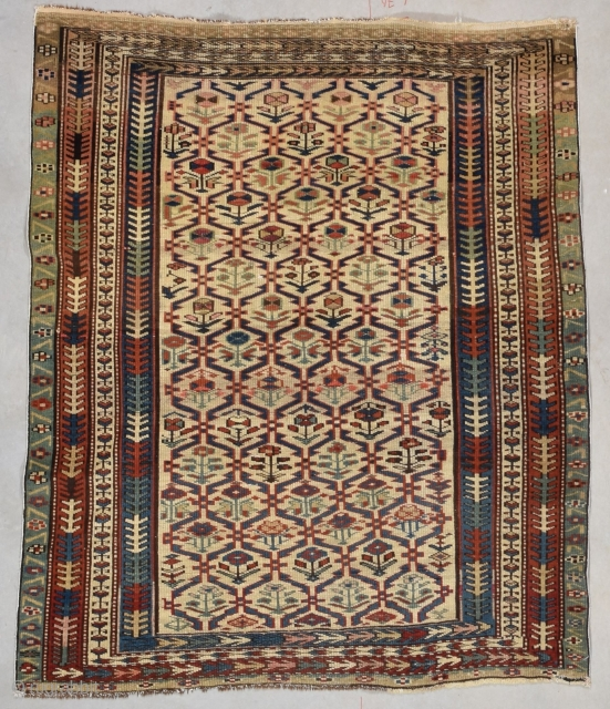 """This circa 1880 Kuba #7739 antique rug measures 3'3"""" X 3'9"""" (100 x 117 cm). It is a cute little Kuba with a lattice design on an ivory ground. Each part of  ..."""