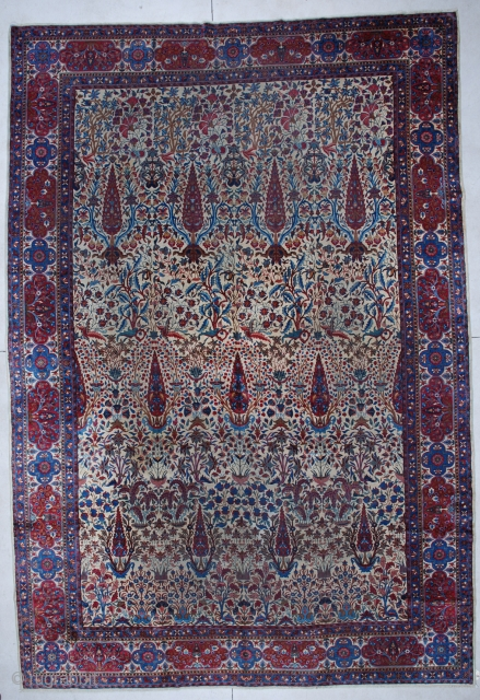 """#5927 Laver Kerman  This circa 1880 Laver Kerman antique Persian Oriental measures 9'9"""" X 14'6"""". It has an ivory field with a one way overall design of red potted trees interspersed with  ..."""