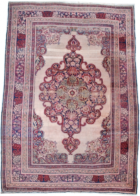 """# 7072 Antique Kermanshah  This circa 1880 antique Kermanshah Persian Oriental Carpet measures 9'2″ x 12'10"""". It has a beautifully drawn large pulled medallion in pale green, cherry and navy blue on an  ..."""