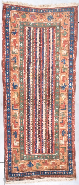 "Antique Kazak Rug  #7862 This circa 1880 Kazak Oriental rug measures 4'2"" X 10'6"".  The field design is the so called Cane design consisting of stripes with a meandering 'S'  ..."