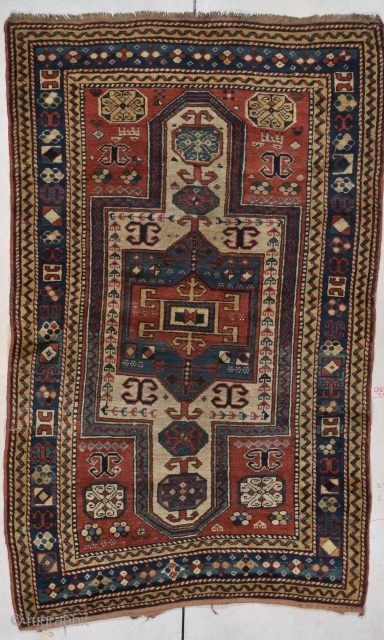 """This circa 1870 Sewan Kazak antique rug measures 3'7"""" X 5'9"""" (113 x 180 cm). This is a very lovely and interesting little rug. A Sewan  Miniature! I have never seen  ..."""