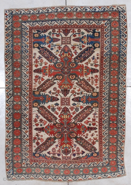 """This circa 1875 Seyhore Kuba Antique Oriental Rug measures 4'5"""" X 6'5"""". It has two complete Saint Andrews crosses on an ivory ground. It has nice asymmetrically drawn field motifs. It has  ..."""