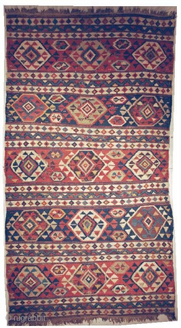 "This circa 1870 Shirvan kilim measures 4'10"" x 9'0"""". The blacks are oxidized causing some small holes. There is a small nick at one end. The sides are complete