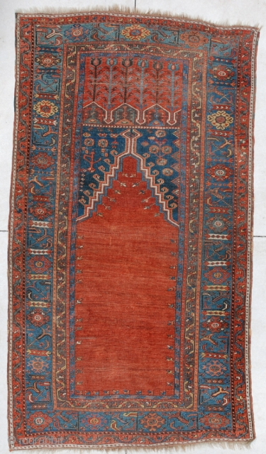 """#5988 Ladik Antique Turkish Prayer Rug  This lovely Ladik measures 3'10"""" X 6'11"""". It dates from the 18th century.  It's all there… The tulips at the top, the spandrels filled with  ..."""