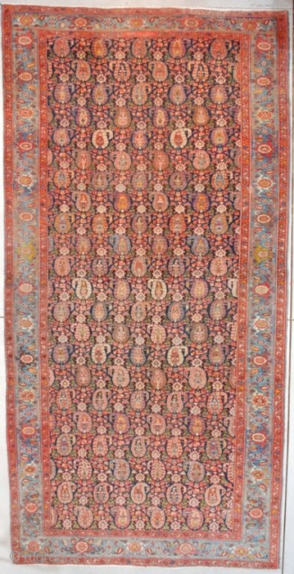 """This circa 1910 antique Heriz #7558 Oriental Carpet measures 6'10"""" X 13'9"""" (210 x 423 cm). This to my eye is a unique Heriz. I have never seen this design in a  ..."""