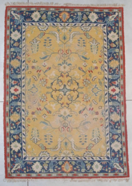 "This first quarter  20th century Oushak measures 8'2"" X 11'6"" (250 x 353 cm). It has a well saturated saffron field with an overall floral design in blue, green, ivory, and  ..."