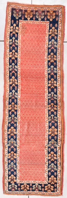 """Turkish Runner #7869 This circa 1930 Turkish runner measures 3'0"""" X 9'7"""". The center field is a pale red color with a lattice work design where every opening in the lattice is filled  ..."""
