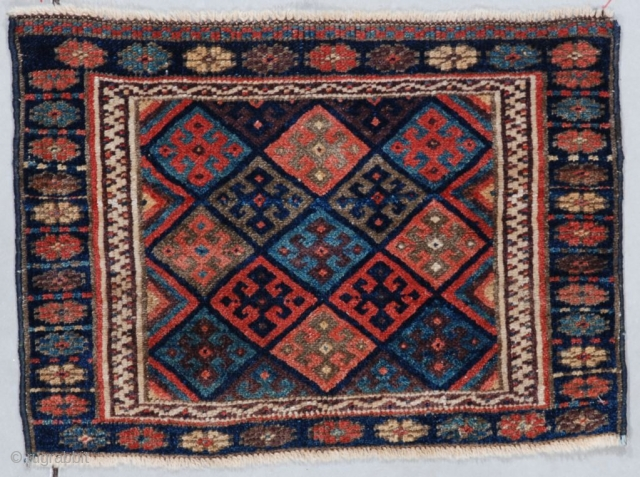 "This last quarter 19th century Jaf Kurd (INV 7561)measures 1'7"" X 2'2"" (51 x 67 cm). It has a field filled with typical Jaf Kurd diamonds. It has all veg dyes. It  ..."