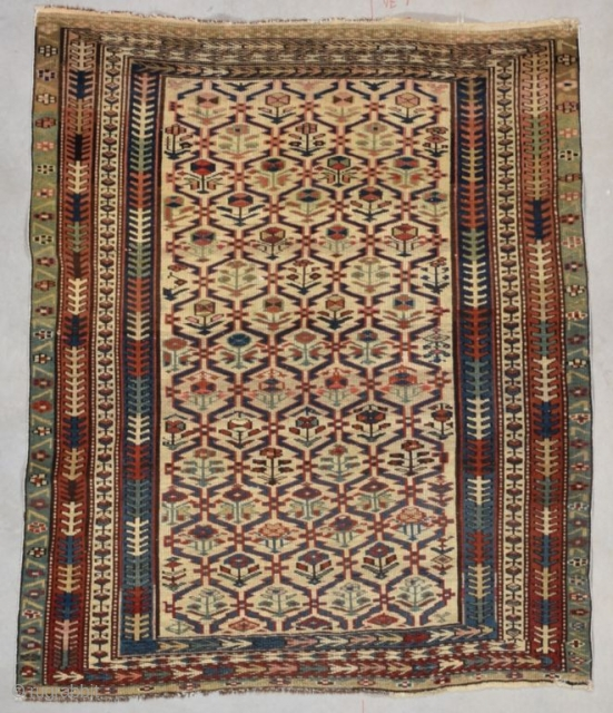 """#7739 Kuba This circa 1880 Kuba antique rug measures 3'3"""" X 3'9"""" (100 x 117 cm). It is a cute little Kuba with a lattice design on an ivory ground. Each part of  ..."""