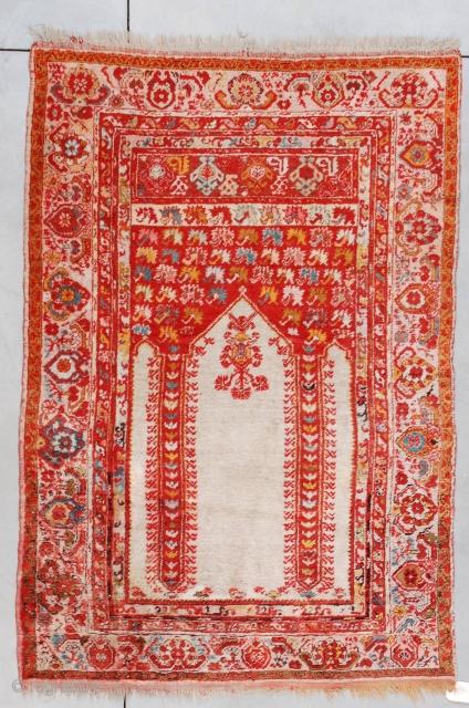 "#7259 Angora Wool Kula antique Turkish Rug  This last quarter 19th century Angora Kula measures 4'4"" X 6'3"" (135 X 192 cm). It is a coupled column prayer rug with an ivory field  ..."