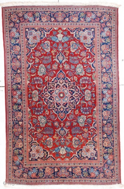 "http://antiqueorientalrugs.com/persian4.htm This circa 1930 European quality Kashan measures 4'4"" X 6'9"". It has a pulled floral medallion on a tomato red ground with fleur de lis in the corners in sky blue  ..."
