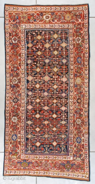 """#7451 Mahal This 1st quarter 20th century Mahal measures 5'0"""" X 10'2"""" (152 x 310 cm). The field motif is a very complicated Herati design on a blue ground. The complication comes in  ..."""