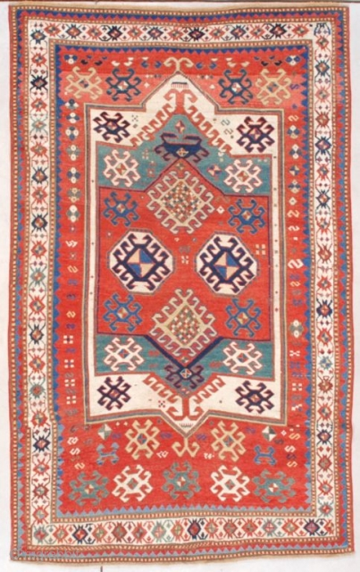 "This circa 1880 Kazak (INV 7569) measures 4'7"" X 7'6"" (143 x 231 cm). This sort of Sewan looking Kazak has a tomato red field with a large ivory medallion, on top  ..."