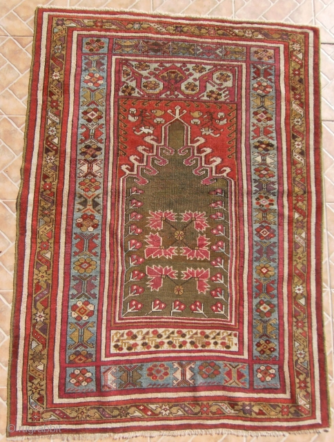 "An attractive Kirshehir Prayer rug with classic ""mihrab"" panel, 5.22 ft. x 3.8 ft.  (160 x 115 cm.) Around 1860-1870. 