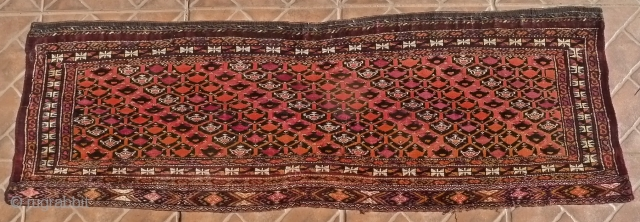 A Saryk Torba, part magenta silk and white cotton, 126 x 41 cm. late 19 th. cent. Typical dark chocolate ground.  In very good condition. Dyes: natural and synthetic.