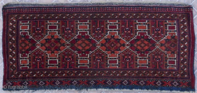 Salor or Tekke Torba, 125 x 55 cm. late 19 th. century. Another enigmatic Turkomen puzzle. The design clearly modeled on an earlier Salor weaving. It has the characteristic cross and diamond  ...