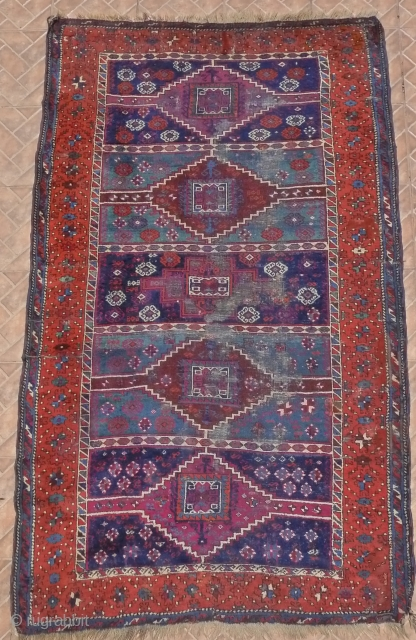 An antique Yuruk rug, Erzincan region, Eastern Anatolian, 225 x 135 cm. (7.4ft x 4.4ft.) late 19 th. century. The design with five panels in brilliant dark blue and and sea-green, each  ...