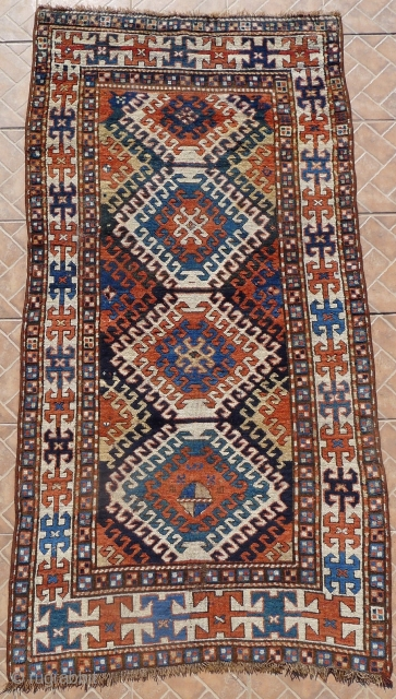 Kazak Rug, Bordjalou region, SE Caucasus, 215 x 11 cm. (7.05ft x 3.7ft) Probably 3 rd. qtr. of 19 th century. The design with a column of latch-hooked diamonds on a dark  ...