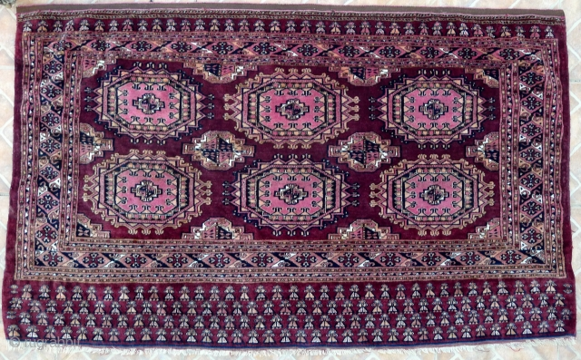 Saryk Chuval, 4.9ft x 2.9ft (148 x 90 cm) late 19 th. century. Majestic Salor Gul design on a dark brown ground. Interesting elim motifs, which appear to be human shapes. Fine and  ...