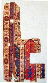"Fragmentary 15th. century tripartite prayer rug, mounted 53"" X 28""[135 X 71cm]"