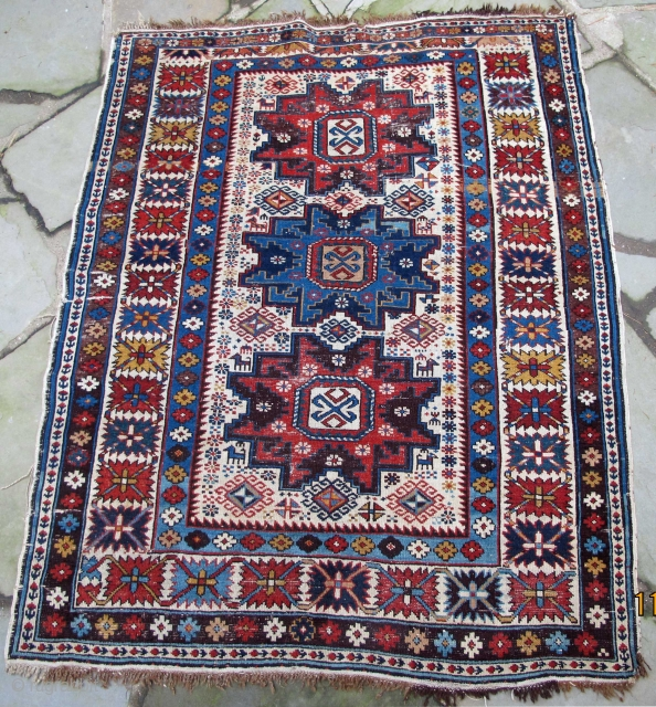 """Finely woven Daghestan from the Caucasus, acceptably low pile, original selvedges, original kelim end finishes with knotted warps, early natural colors including a wonderful maroon, 19th century, 56"""" X 45""""[143 X 114cm]"""