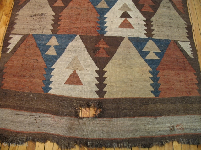 Antique Uzbek Kilim.  Nice tribal design.  Looks like little homes to me.  Good repair project.  Some holes.