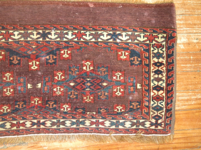 Antique Turkoman.  Size 2'7''x1'3''.  Needs a bath.  Condition is as shown...  maybe once wider?  Pile seems to be all there.  I really don't know much about  ...